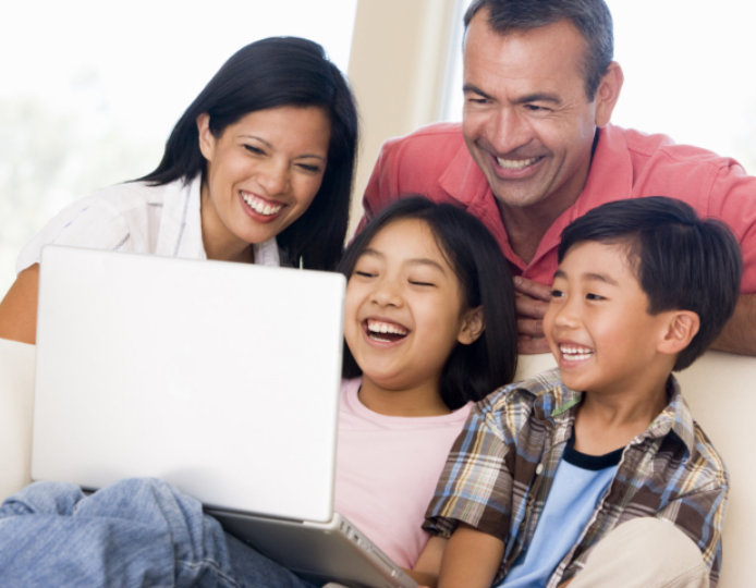 family watching movie on laptop